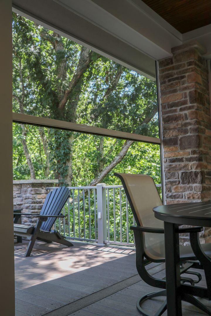 retractable screen on an outdoor room deck