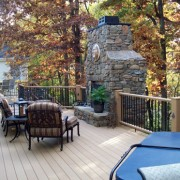 GeoDeck composite deck with stacked stone fireplace