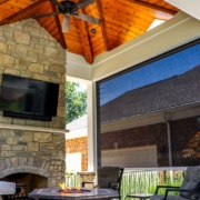 beautiful fireplace, ceiling and retractable screen