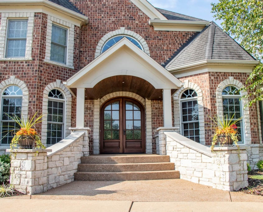 grand front entrance that helps boost homes value and curb appeal