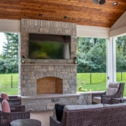 Fireplace feature in an outdoor room pool house