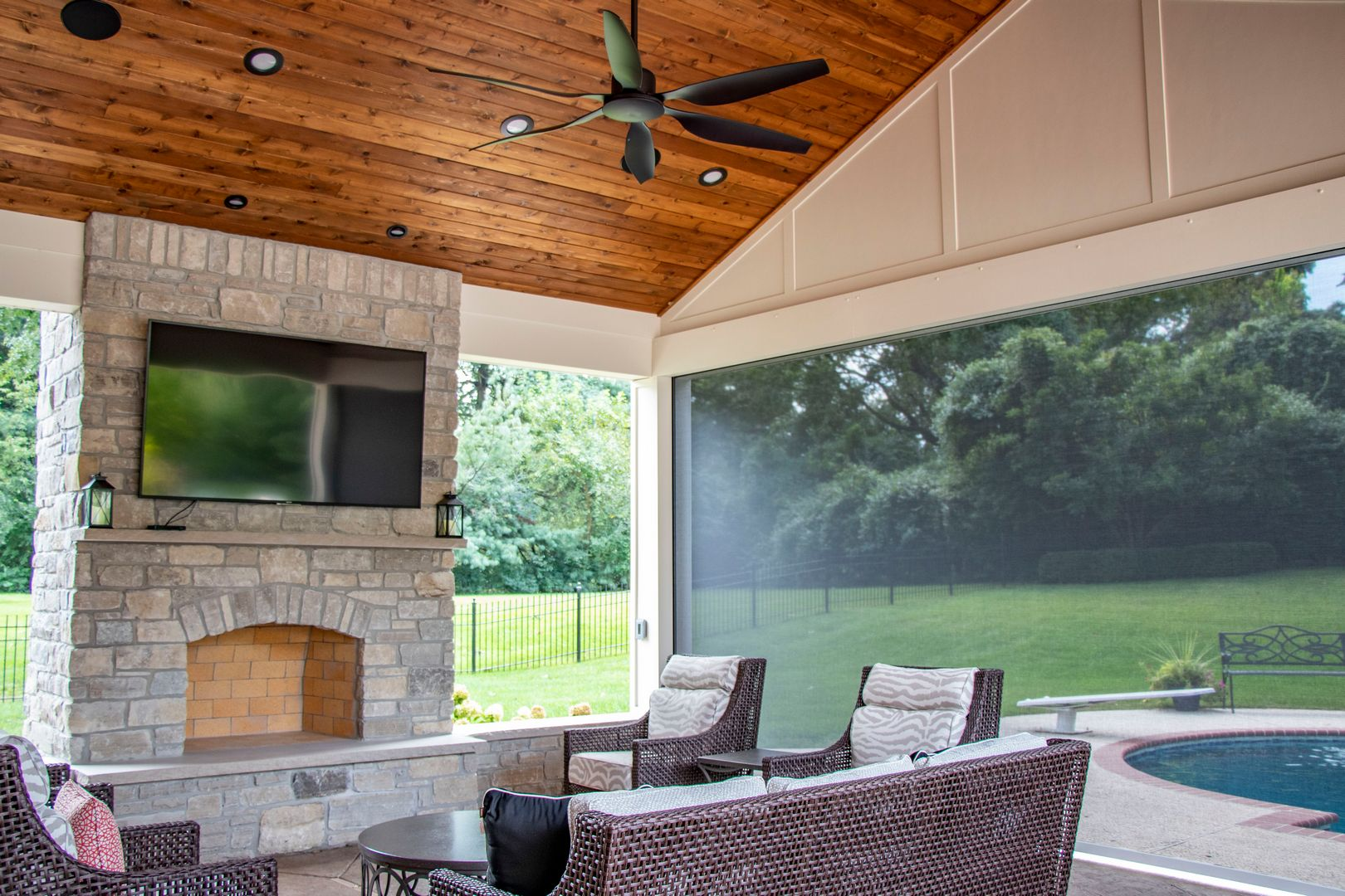 retractable screen wall on a pool house