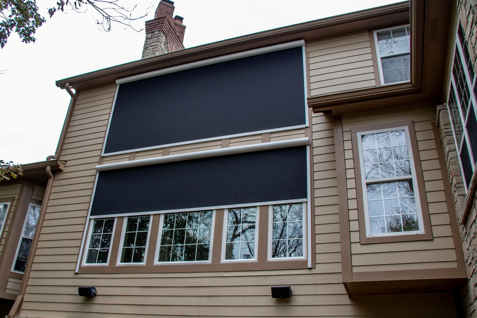 Retractable solar screen wall added on to large windows to block/protect the home from the west sun