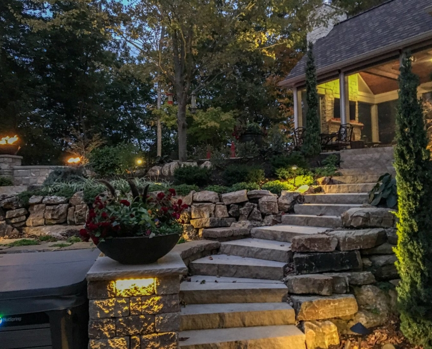 Outdoor space with custom steps leading to an outdoor room
