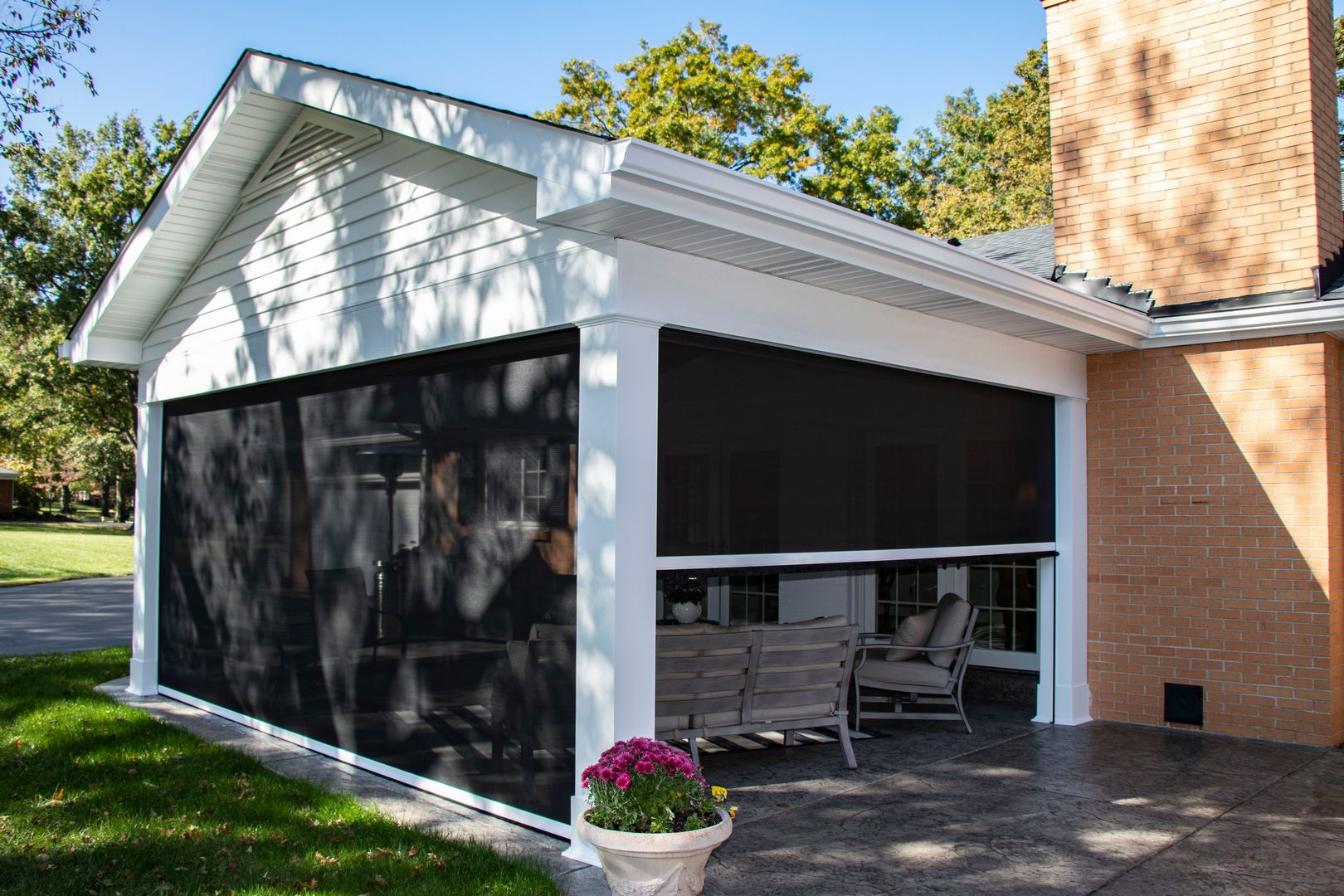 An outdoor room addition with three retractable screen walls