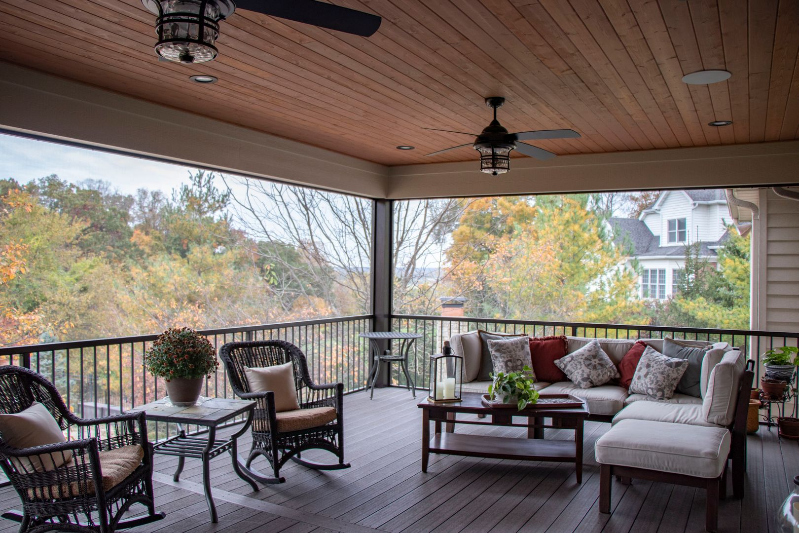 The interior of an outdoor screen room addition on a composite deck