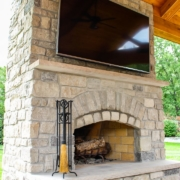 custom outdoor room fireplace with TV mount
