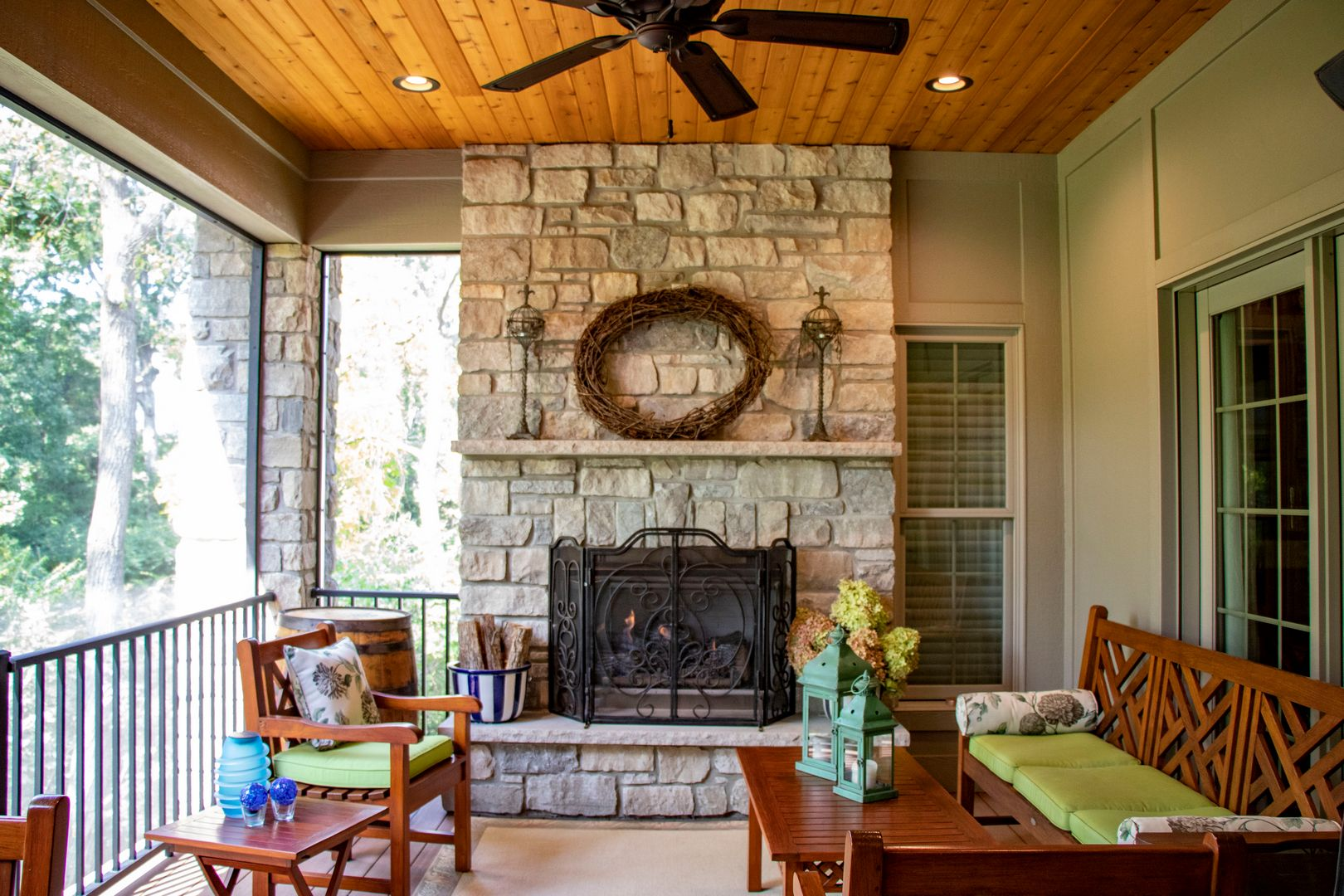 Outdoor screen room with a fireplace