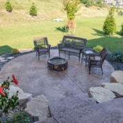 decorative concrete patio next to an outdoor room