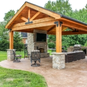 outdoor room located on a custom stamped concrete patio with a gorgeous fireplace feature