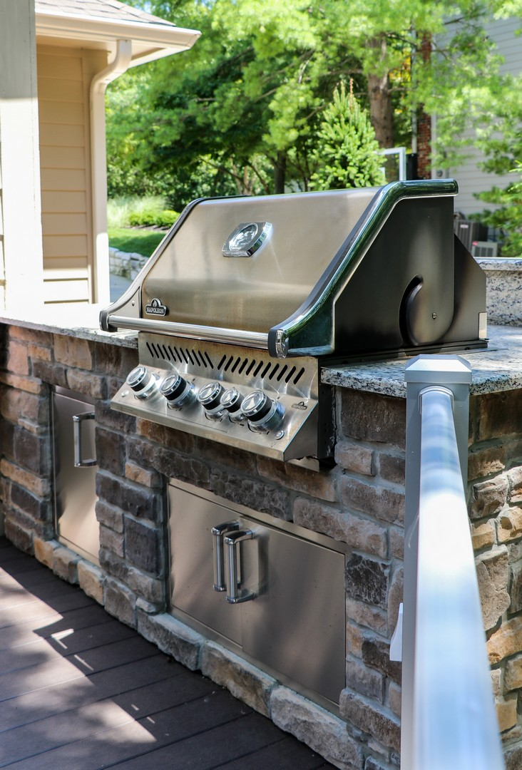 cook and serve your guests without missing the fun with an outdoor room grill