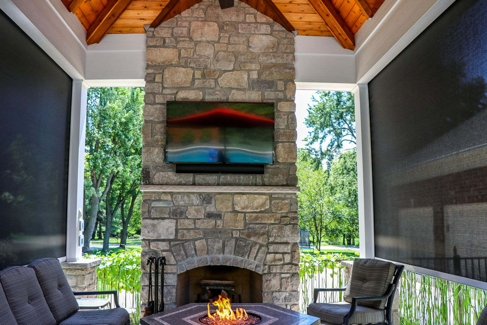 Fireplace with retractable screens that help provide warmth during the cooler seasons