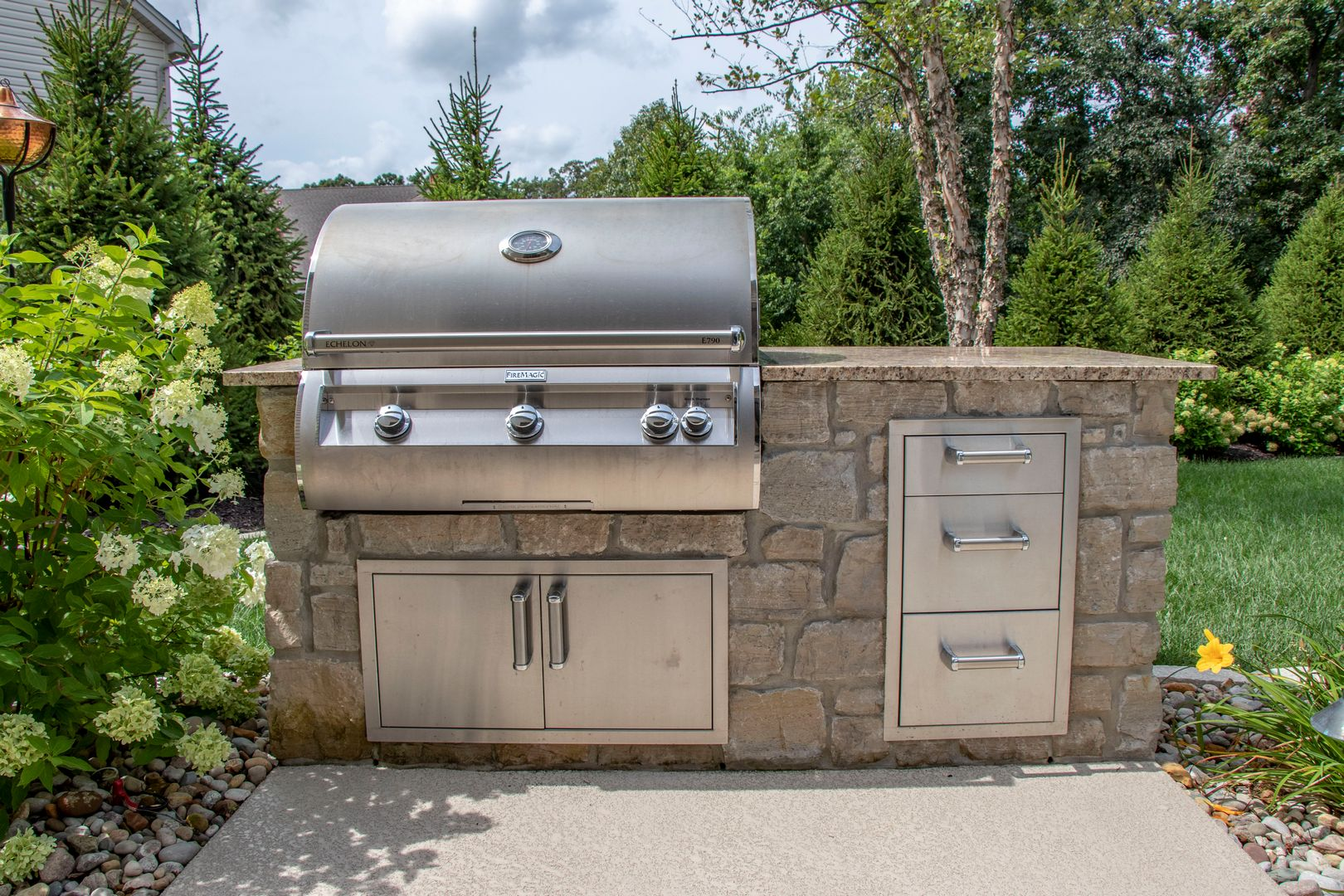 A grilling and storage center located outdoors