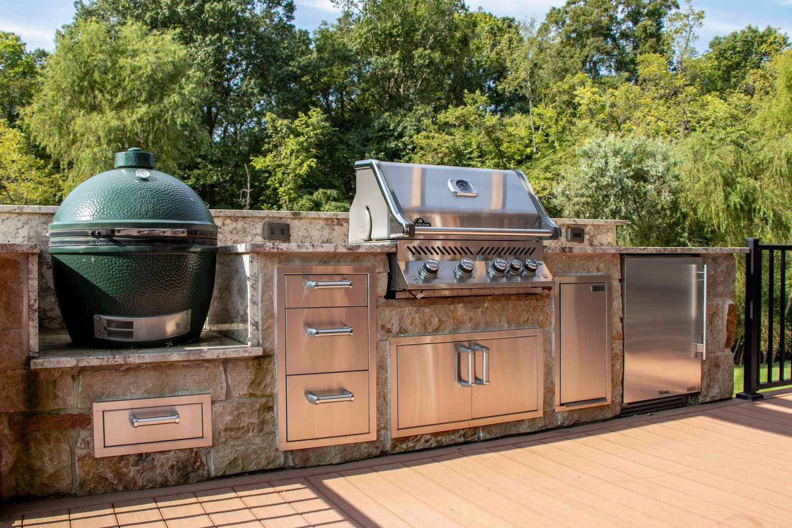 A grilling and beverage center located on a patio for convenience