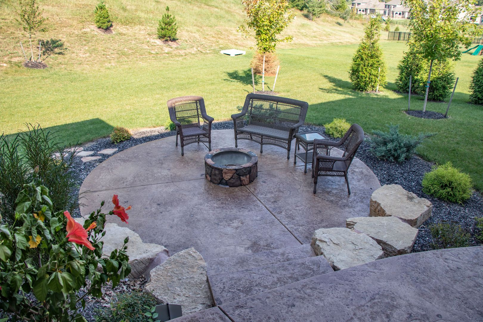 A beautiful custom patio with a fire pit perfect for any occasion