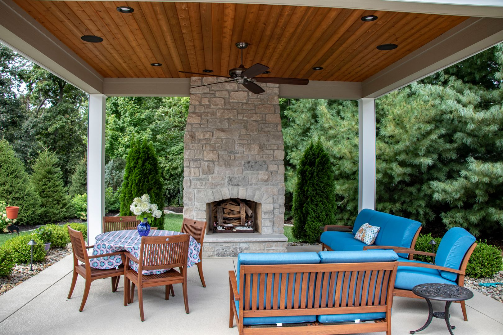 adding comfort to the outdoors with a beautiful fireplace