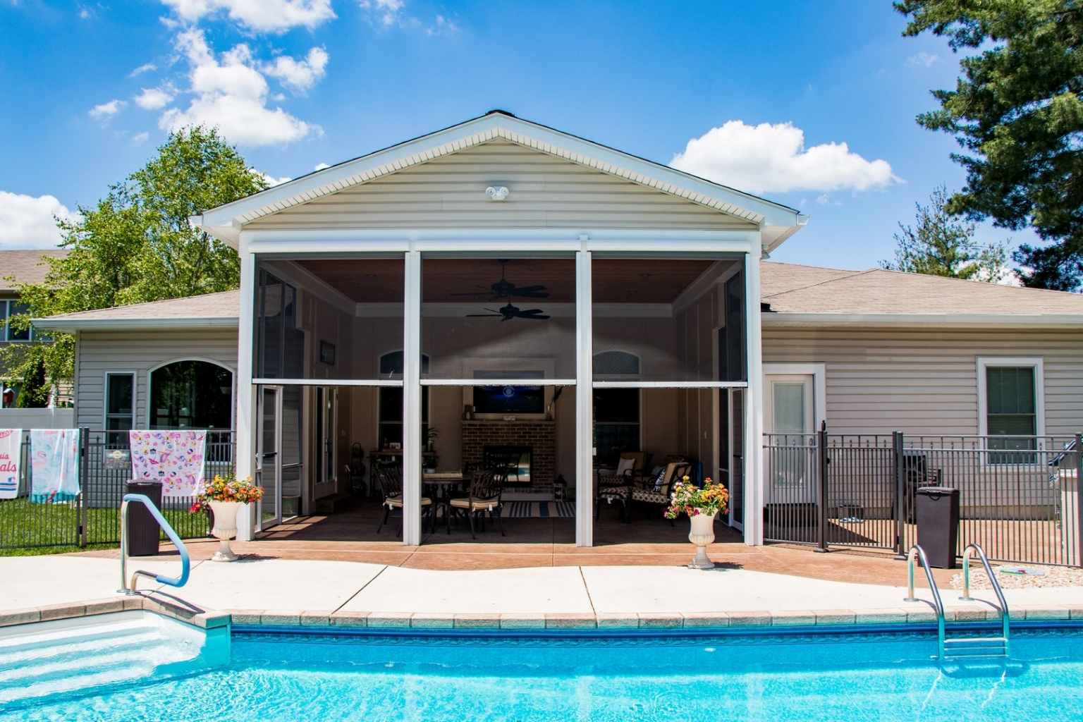 Retractable screen by a pool