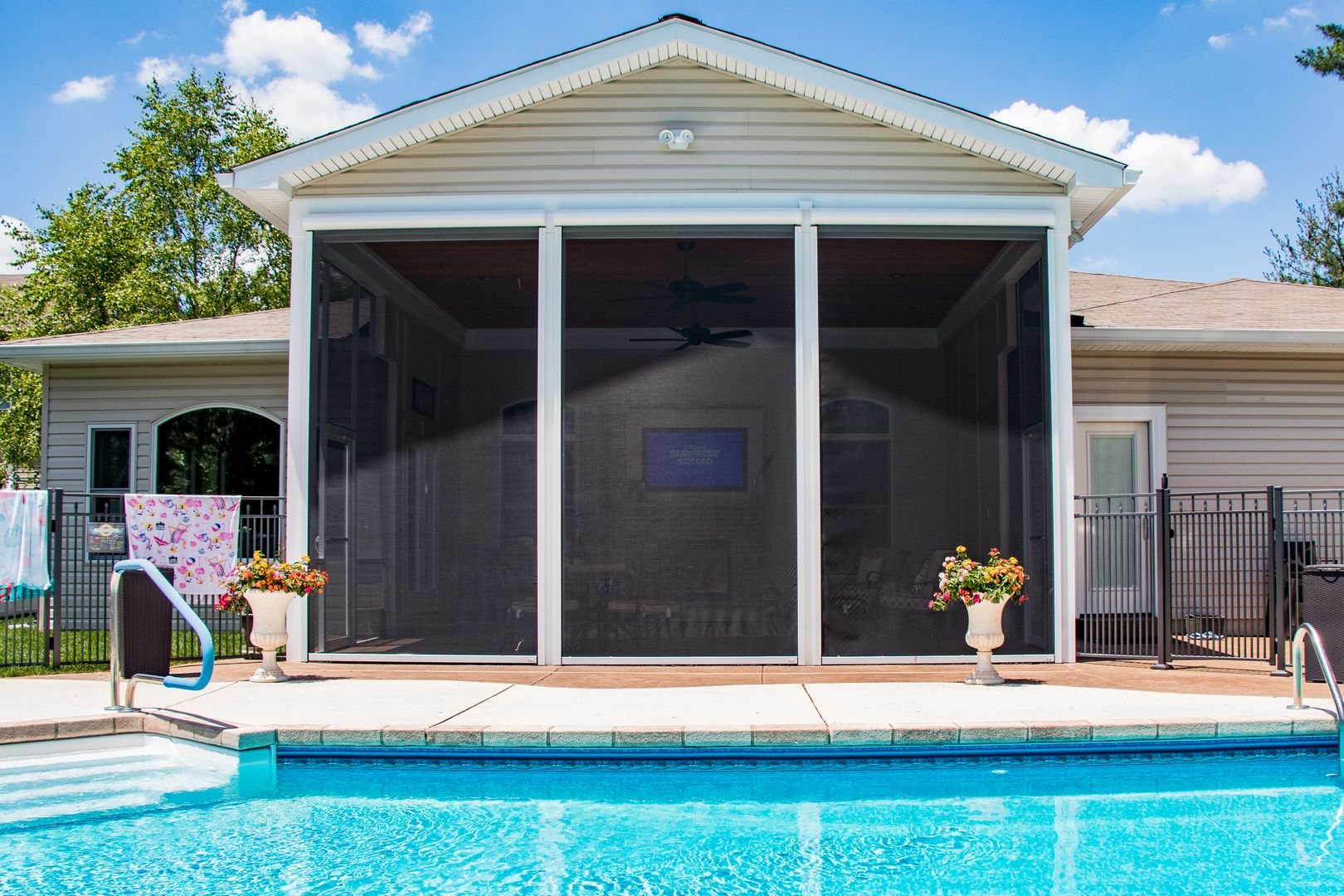 retractable screens on a room addition