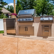 outdoor kitchen with grill and storage