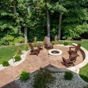 decorative concrete patio with fire pit