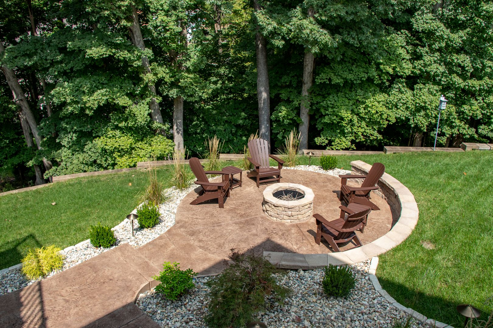 decorative concrete patio with fire pit